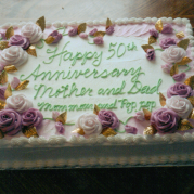 Purple and Pink Flowers with Gold Leaves on a 50th Anniversary Cake