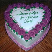 Purple Flowers On Heart-Shaped Cake