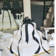White Tower Cake With Black Ribbons